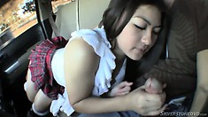 Hot little Asian number fingers in the car and then munches cock
