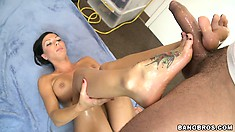 Rachel Starr pets long skin snake with her nice, tattooed feet