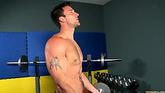 Muscled gay stud works out in the gym and works up a nice sweat