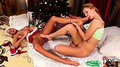 Santa brought her a kinky girlfriend who loves to suck her feet