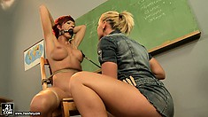 Tattooed redhead gets handled by Kathia and gets gagged in the chair