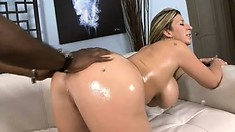 Sara Jay oils up her ass and tits as she fucks his big black cock