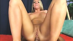 Pretty blonde with big tits and a lovely ass invites a black stud to drill her holes