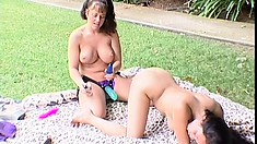 Hot Asian lesbian moans while getting her twat plowed with a strap-on