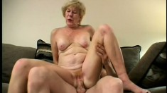 Naughty mature lady Diana has some fun with two big cocks on the sofa