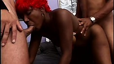 Red haired ebony babe with a big round booty blows and fucks two cocks