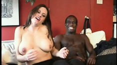 Busty young brunette has a white guy and a black dude sharing her twat