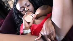 Allustrious black whore in red underwear Jada Fire sucks dildo and rubs clit