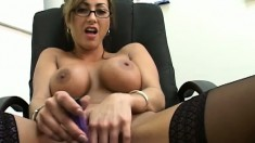 Nasty spectacled lady explores her pussy with some long toys