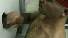 Lustful gay studs blow each other's long pricks at the gloryhole