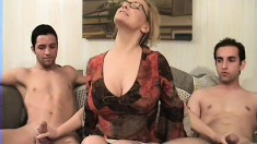 Busty spectacled MILF services two lucky young dudes in hot threesome