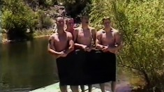 Four guys go skinny dipping and explore each other's masculine cocks