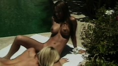 Out by the pool these two lesbian lovers lick and suck each other