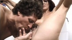 Slutty milf has two horny guys roughly banging her holes in the toilet