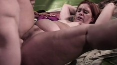 Dirty redheaded chick goes down on her hunky mechanic's prick