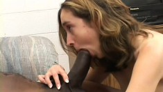 Petite blonde with small tits has two massive black cocks stretching her tight cunt