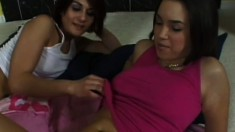 Brunettes fluff each other up, then strap a dildo on and go banging like crazy