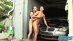 Horny mechanics John Parker and Rudy Bodlak have sex in the garage
