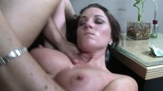 Voluptuous brunette reveals her juicy tits before getting slammed hard