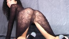 Skinny Asian babe in a long dress exposes her naughty cunt on camera