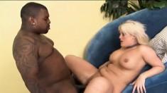 Voluptuous blonde Julie Cash knows her way around a huge black stick