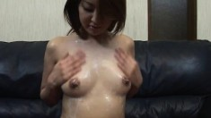 Asian girl seems to be happy to be covered in cum and her mouth filled with it