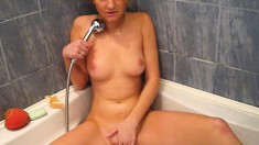 Provoking blonde girlfriend indulges in intense orgasms in the bathtub