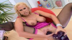 Voluptuous blonde milf in lingerie Kylie G fucks herself with big toys