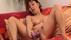 Mature lady is home alone and indulges in a little afternoon toy delight