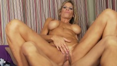 Fake tit MILF gets a young bone to eat and drill her in the cootch and ass