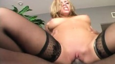Striking blonde with perky boobs fucks a black dick and gets creampied