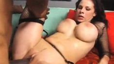 Big breasted brunette has a dark stud filling her twat with his juices