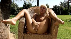 Slender blonde with sexy long legs and a perky ass fingers her peach