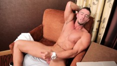 Muscular tattooed stud gives himself a foot rub and ends up wanking naked