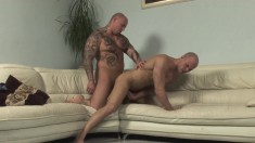 Tattooed bald stud lets this eager gay dude suck on his boner