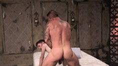 Horny stud sucks his pal's thick cock and gets his ass pounded in bed