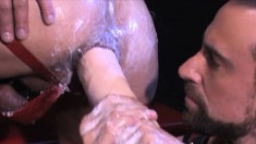 Mesmerizing gay stud fully enjoys receiving a fist up his juicy butt