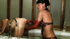 Mistress Carmen River toys fucks his ass and then uses a strapon
