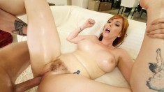 Redhead with nice knockers spreads wide with legs behind her head