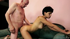 Brunette whore gets her young face covered in an old man's cum