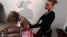 She gets gagged and her mistress starts fucking with her on the chair