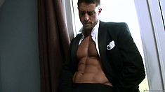 Elegant chap is undressing slowly and showing tasty parts of his body