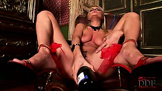 Slutty slim lesbian touches her almost shaven cunt with a bottle of beer