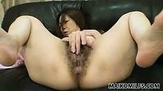 Hairy pussy of a hot Japanese slut gets warmed up with tongue and a couple of toys