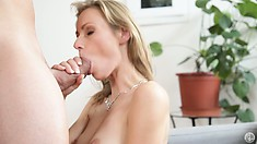On Her Knees, The Hot Babe Has Her Lips Giving That Cock Her Very Special Treatment