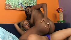 Saucy ebony babe loves having her girl's tongue deep inside her pussy
