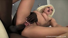 Whitney Grace, a sweet blonde with a spicy ass, takes a black rod deep in her cunt