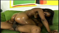 Ebony girl with a big booty Cali Caramel sucks and fucks a huge black rod with passion