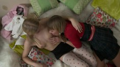 Horny pigtailed lesbians bring out a strap-on for some sensual sex