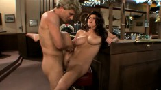 Big breasted cougar Sara Stone fully enjoys a hard pounding in the bar